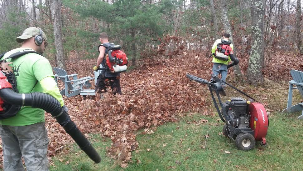Men Blowing Leaves