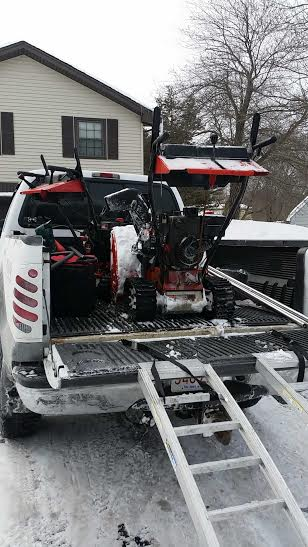 snow blower in truck